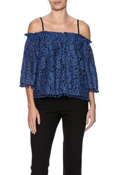 Blue lace top with off the shoulder 3/4 sleeves, elastic bust line, adjustable spaghetti straps, and pompom trimming.   Blue Lace Blouse by Ina. Clothing - Tops - Long Sleeve Clothing - Tops - Blouses & Shirts Clothing - Tops - Off The Shoulder New York City Manhattan, New York City