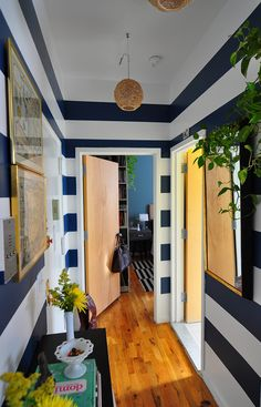 I love these navy hallway stripes.  I would hang maps on the wall too.  They just seem to be a perfect fit.