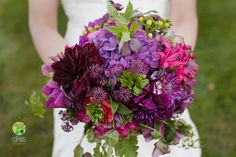 green and purple wedding | Bouquets of burgundy, pinks, and purples. Photo by Ciras Photography.