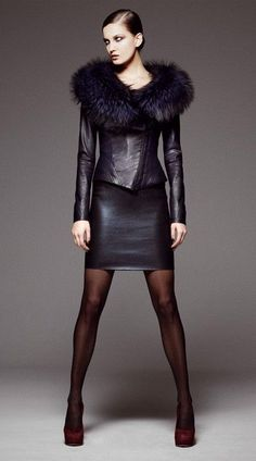 Leather skirt and jacket with extended fur trim.