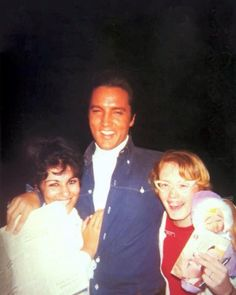 Elvis Presley posing with fans outside his Hillcrest Road home, Beverly Hills, CA, c. 1968.