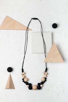 Geometric minimalist necklace by Black & Beech. Beautiful and unique teething jewellery, made with child-safe BPA-free food-grade silicone beads and untreated wooden beads. #teething #blackandbeech