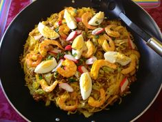 Pancit Malabon is a Filipino dish that is a type of pancit, or stir-fried noodle dish, which originated in Malabon City, Metro Manila, Philippines. It has a yellow-orange color owing to a sauce that includes patis (fish sauce) and crab fat. Its toppings draw heavily from the fresh seafood that is available in the area and may include fresh shrimp, squid, oysters, and hard-boiled duck or hen eggs, as well as pork.