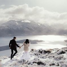 -  Alana + Louis, exploring the mountains of Queenstown only moments after saying their vows in their private elopement.  As seen on the @hellomaymagazine blog.  ~  For more photos and a short film from their magnificent adventure, visit our website {LINK in profile}.