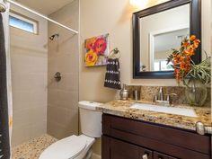 Transitional 3/4 Bathroom with Golden Riviera Granite Countertop, Interlocking Random Sized Natural Stone Mosaic Tile