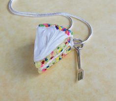 Hey, I found this really awesome Etsy listing at https://www.etsy.com/listing/156557331/funfetti-cake-and-a-fork-polymer-clay