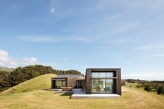 Situated on a hilltop overlooking Kapiti Island, the Peka Peka House is designed with its coastal setting in mind. A trio of rectangular volumes makes up the compact structure. The two blackened cedar-clad forms - one for living and one...