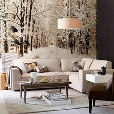 I hate the furniture and accessories in this room but am loving the idea of a huge woodsy scene as a wall piece. I'm thinking green forests of washington state?? Like that door in the hunger games!?