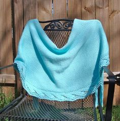 Knitting can be an all seasons sport.  The Ocean Waves Wrap will keep any breeze off of your shoulders.  A pretty lace edging gives this knit wrap pattern a bit of flare, while a stockinette body makes up most of this wrap.