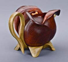 Teapot sculptures carved in wood. Teapot purses and nature wood carvings in teapot forms. Coffee Set, Coffee Cups, Tea Cups, Wood Carvings, Tea Cup Saucer, Home Deco, Wood Art, Sculptures, Porcelain
