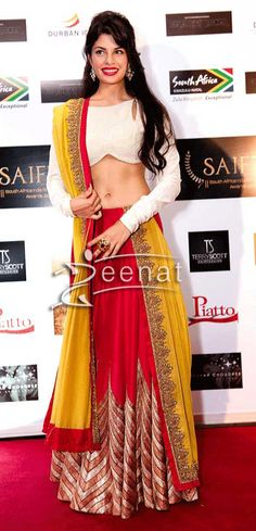 Jacqueline Fernandez wore a full sleeved designer choli in white while the red and yellow Lehenga is having contrasting colors embroidered from the pallu borders. She was seen at the South Africa India Film and Television Awards' (SAIFTA).