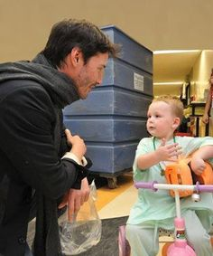 """Pretty sure this is one if the cutest things I've ever seen. Keanu Reeves on the most important thing of being a father: """"To be around for your child and not be a stranger. If you plan to be a parent you have to be willing to be committed. Children take priority in your life, or at least they should."""""""