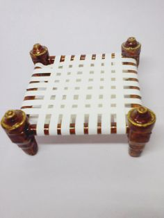 This square cot is made with waste xerox papers cut into quillint strips (quilling item) Quilling Ideas, Paper Quilling, Krishna Janmashtami, Indian Dolls, Newspaper Crafts, Waste Paper, Festival Decorations, Paper Models, Paper Cutting