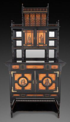 Furniture : English, A VICTORIAN AESTHETIC MOVEMENT EBONIZED AND PAINTED MAHOGANYCABINET, in the manner of Thomas Edward Collcutt, (English, 184... Image #1