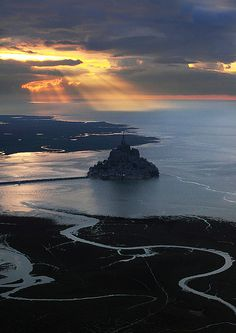 Mont Saint-Michel, Normandy, France - at certain times is engulfed by the water and reveals the splendor of construction. Set in a medieval town called Avranches, this monastery was fortified in the thirteenth century..