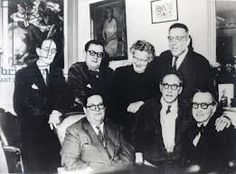 And here are our six spectacled members (pictured with friend Jean Cocteau). L-R standing: Louis Durey, Georges Auric, Germaine Tailleferre, Francis Poulenc. L-R seated: Darius Milhaud, Jean Cocteau, Arthur Honegger