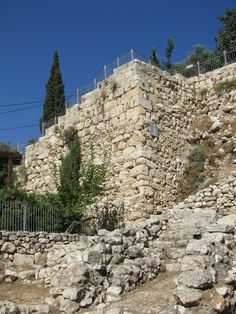 The lower courses of this straight wall of Jersualem were laid by Nehemiah and his wall builders in 445 BC. The Hasmoneans then rebuilt it by laying the upper courses of block around 160 BC.