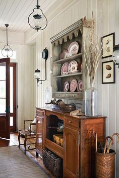 Pairing heirlooms like a china set or these oil-rubbed kerosene lanterns with exposed wood plank walls is a great way to add character to your point of entry.  Tour the rest of this home