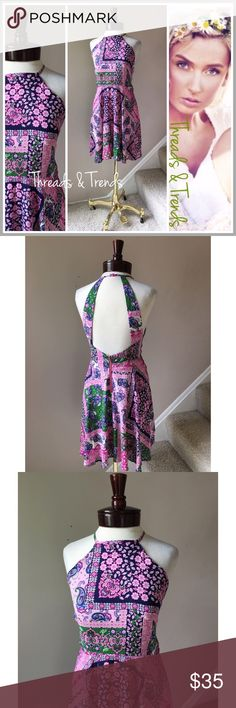 LAST ONE! Sexy Paisley Tank Dress Unique blend of periwinkle pink, navy and green paisley floral print, patchwork  halter dress. Look adorable in this unique vintage design. Embellished button closer at neckline and zipper closure at the waistline. Made of rayon. The perfect summer date night dress.                                                                       Available in S, M. Striped Threads & Trends Dresses Backless