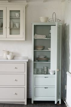 The Real Shaker Kitchen by deVOL - This little pantry cupboard is painted in 'Verbena' which is one of our seven shaker paint colours. This pantry is the perfect size to slot into an awkward small space and it provides great storage with shelving, drawers and spice racks too!