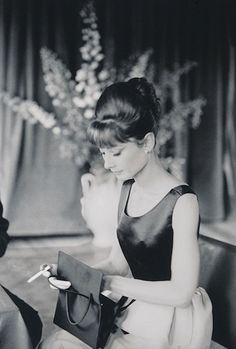 almost nothing makes me smile like old photos of Audrey Hepburn do.