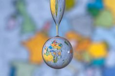 German photographer Markus Reugels. Using large satellite photos as a backdrop and a high speed camera he captures the background's refraction through water drops. The perfectly timed shots result in these spherical representations of the Earth, Moon and Jupiter. See much more of his work here and also here. Thanks Markus for sharing your work with Colossal!