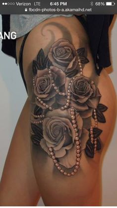 Flower Tattoos - Black and White Rose Tattoo hip thigh. Would get smaller flowers and lots of color, but love the idea of stranding pearls through the vines. Girl Thigh Tattoos, Side Tattoos, Body Art Tattoos, Sleeve Tattoos, Tattoo Sleeves, Tatoos, Tattoo Thigh, Forearm Tattoos, Thigh Tattoos For Women