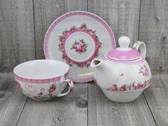 Porcelánová souprava na přípravu a podávání čaje.    Sada obsahuje: podšálek, hrneček,konvičku a pokličku.