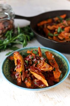 Roasted sweet potatoes toss with cranberries, pecans, parsley and warm bacon apple cider dressing. For Thanksgiving or any time of year.