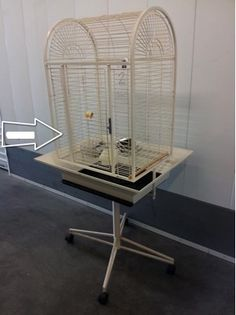 """Cage #42 - NOT AVAILABLE. inside 22""""x17""""x30"""", B/S 1""""; one piece stand/cage; dome top; broken lock; 57"""" to top of dometop; has seed flanges which give it a width of 29""""x24"""". Went to Fresno/Bradley Stottler."""