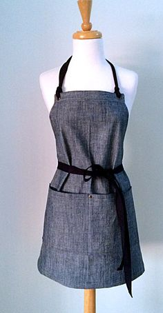 The full womans apron is made from a sturdy 10 oz cotton fabric. The fabric looks like chambray with the vertical thread being indigo color and the horizontal thread being a natural color--really attractive and versatile! Great apron for a business or an individual. Please see the included closeup photo of the fabric.  Custom Monogramming Available:  One Letter: http://www.etsy.com/listing/467086000/apron-monogrammed-personalized-apron?ref=shop_home_active_1  Thr...
