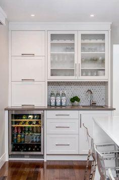 white shaker cabinets; gray countertops; blue/gray marble geometric backsplash