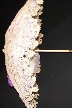 A 19th century folding handle parasol with a hand made lace cover.