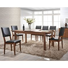 Sleek and stylish, this collection of contemporary dining furniture features American walnut and hardwood construction. Its matte unstained finish brings out the natural beauty of this wood species. #furniture #vancouver #yvr #dining