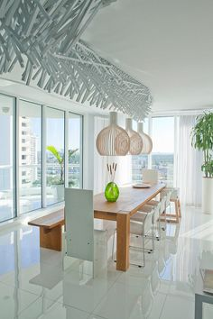 Greetings from Florida! Our Octo 4240 pendants in a bright contemporary apartment called Cassab. Design by Glottman.
