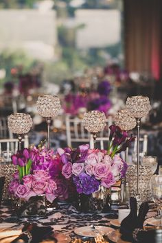 raised sparkly candle holders, shades of purple & patterned linens