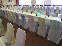 Rainbow pastel chair covers and sashes. South Wales wedding reception dressed by affinity event decorators