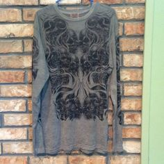 Top Really soft top - gray with black design on front and down sleeves. Never been worn. Tops