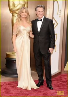 Goldie Hawn & Kurt Russell at the 2014 Academy Awards held at the Dolby Theatre on Sunday (March 2) in Hollywood. Goldie is wearing Versace.