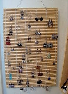 Bamboo placemat jewellery display I would like this in black and hung on a banana hook...hmmm