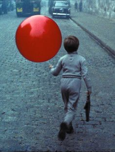 Albert Lamorisse, Le Ballon rouge (film still) In this short French film, the red balloon becomes personified as a character with its own whims, and also serves as a symbol for childhood, or. Red Balloon, Balloons, Balloon Movie, Balloon Dance, Photo Bleu, Film Red, Foto Art, French Films, Rainbows