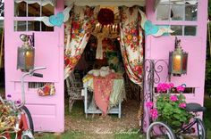 an old shot of our tent entrance. 2005ish. junk gypsy tent at Texas antiques week flea market.