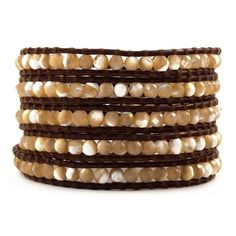This Month's Featured Designer - CHAN LUU. Natural Mother of Pearl & Brown Leather Wrap. Gorgeous, rich mother of pearls have been hand woven with natural hide brown leather making this one of Chan Lu