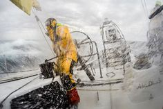 "April 1, 2015. Leg 5 to Itajai onboard Abu Dhabi Ocean Racing. Day 14.  Upwind spray engulfs the cockpit as Luke ""Parko"" Parkinson trims the jib in the Atlantic Ocean Matt Knighton / Abu Dhabi Ocean Racing / Volvo Ocean Race"