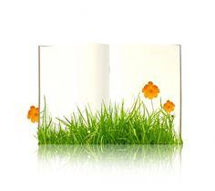 Libro con plantas creciendo delante