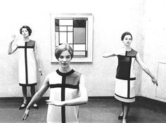 Yves Saint Laurent's De Stijl collection in front of a Piet Mondrian composition, 1966