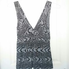 Express Gray, black, and silver V-neck top Empire waist and amazing braided detail on sleeves.  Flow below empire waist.  Worn twice Express Tops Tank Tops