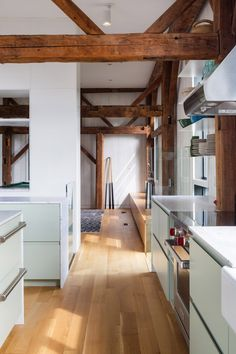 La Firme turns abandoned shed into Quebec home The Barn Wooden Staircases, Wooden Stairs, Modern Recessed Lighting, Mechanical Room, White Staircase, White Counters, Rustic Exterior, White Oak Floors, Green Cabinets
