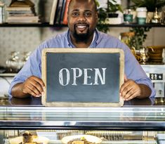 A cheerful small business owner with open sign by Rawpixel. A cheerful small business owner with open sign Business Photos, Business Signs, Craft Business, Wireless Internet Providers, Mexican Fonts, Open Signs, Radio Flyer, Photoshop Photography, Modern Graphic Design