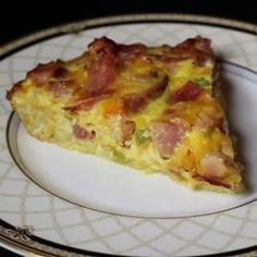 "Ham and Hash Brown Quiche | ""Made exactly as described, and it was great! Loved the crunchy edge of the hash-brown crust. Next time I may leave the crust in longer to get the whole thing a little browner and crunchier."""